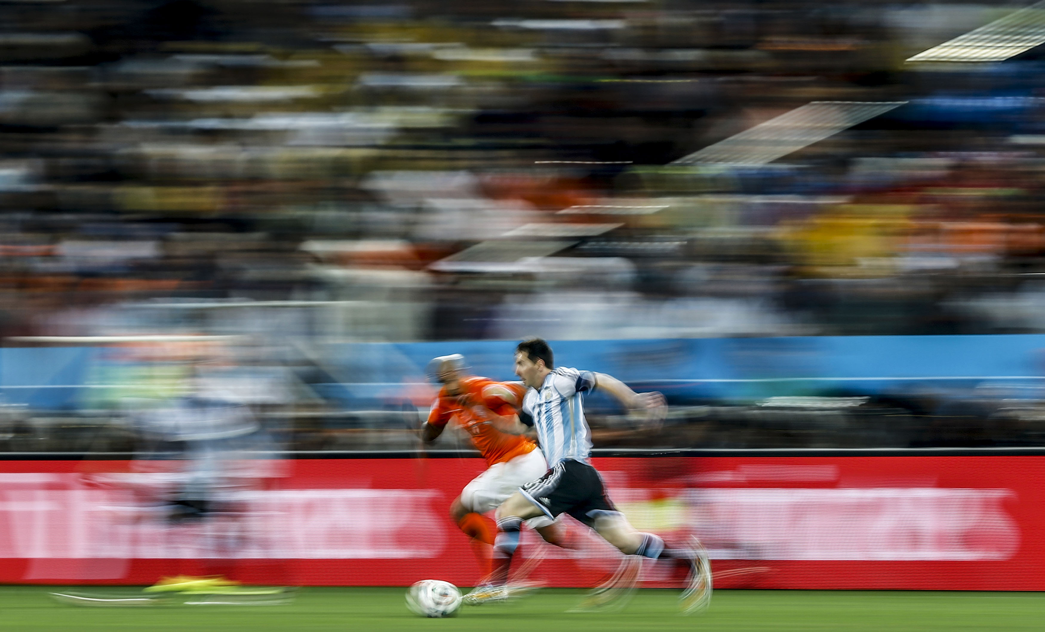 de Jong of the Netherlands fights for the ball with Argentina's Messi during their 2014 World Cup semi-finals at the Corinthians arena in Sao Paulo